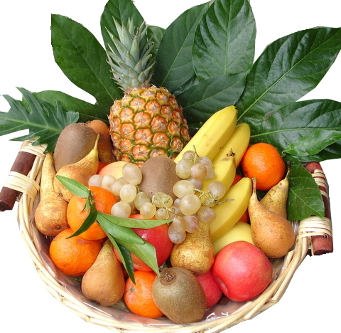 Fruit basket with organic fruits in the room