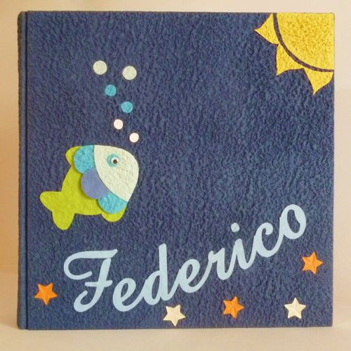 blue photo album with little fish, sun and name
